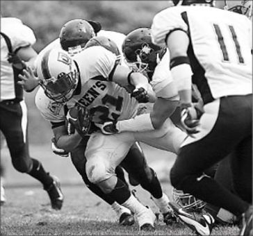 Football running back Mike Giffin lunges forward in a game against McMaster two weeks ago. The Gaels are now 4-0.