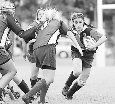 Shauna Geerts makes a run for women's rugby against Trent.
