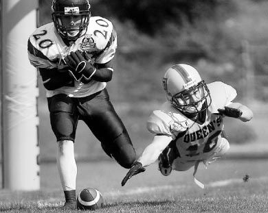 Defensive back Jimmy Allin, who was named Queen's player of the game, stretches for the ball against Laurier.