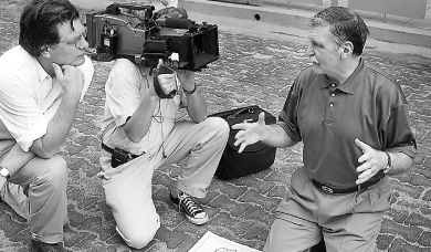 Peter Raymont, left, films a scene with Gen. Romeo Dallaire in Rwanda.