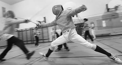 Greg Nonato, the men's sabre captain of the fencing team, lunges forward in a practice. The fencing program is in danger of losing its status as a fully funded interuniversity team.
