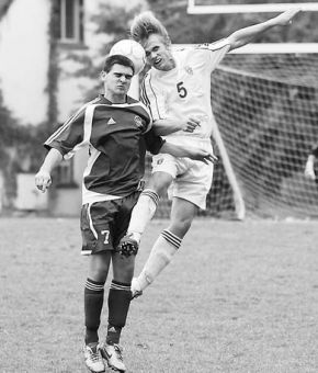 Gaels' defender Michael Zanetti (5) goes up for a header against the Ryerson Rams on Sunday.