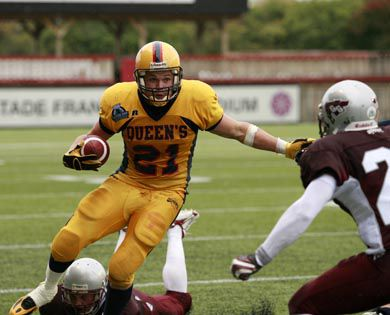 Mike Giffin, the OUA's leading rusher, gets ready to plow through the Ottawa defence in the Gaels' 13-12 loss Saturday.