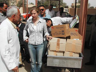 Dr. Samantha Nutt, founder and executive director of War Child Canada and shown here with doctors in Iraq, says Canadians need to start thinking about their relationship to war differently.