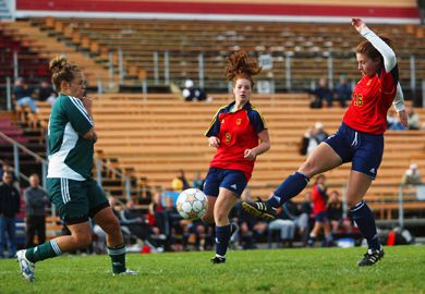 Gaels' rookie striker Danielle Gibson (16) launches a shot Sunday. The Gaels beat Trent 5-0.