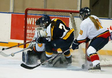 Queen's goalie Katie Boyd challenges Windsor forward Candace Rapchak with defender Katie Duncan in pursuit. The Gaels lost to the Lancers 3-1 on Saturday.