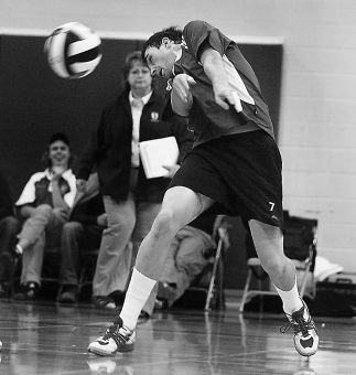 Gaels' middle hitter Chris Vandyk unsuccessfully tries to dig a ball Saturday.