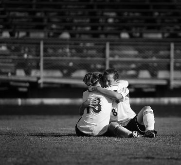 Gaels' defender Ali Skinner (18) comforts midfielder Katie Dalziel after Wednesday's loss to the Royal Military College.