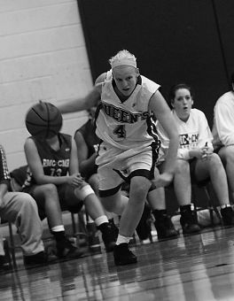 Queen's guard Lyndsey Gauley drives against RMC Friday.