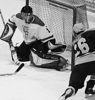 Queen's goalie Ryan Gibb makes one of his 40 saves Saturday.