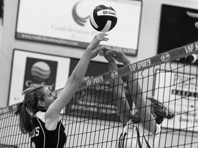Annika Green (left) goes up for a block in the women's straight-sets win over the Royal Military College Paladins Wednesday.