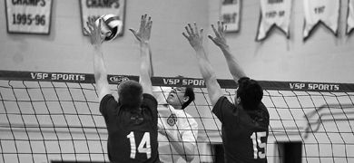 Rookie left side hitter Bryan Fautley (6) goes up for a kill against David Gomes (14) of the Royal Military College Paladins Wednesday night. The Gaels won 3-1.