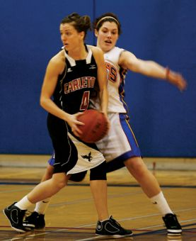 Gaels' point guard Teddi Firmi defends against Carleton forward Alexandria McDonald Friday.
