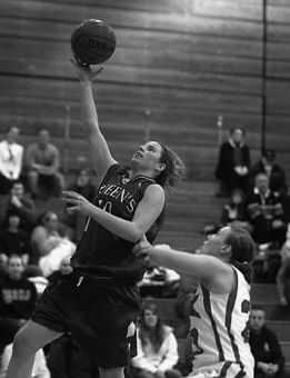 Queen's forward Sarah Barnes tries a layup against Melissa Meacham of the York Lions Saturday. The Gaels lost 71-66.