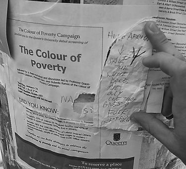 This defaced poster was found on a pole on the corner of Brock Street and University Ave.