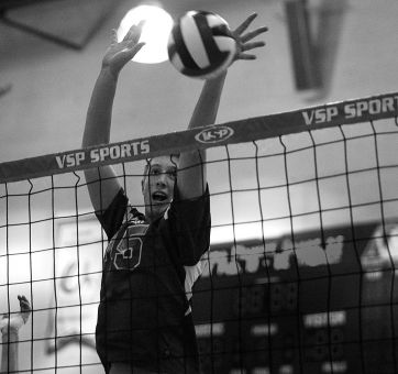 Men's volleyball outside hitter Niko Rukavina goes for a block Saturday night against McMaster. The Gaels lost in four sets.