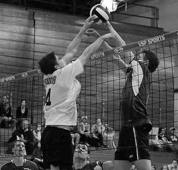Queen's setter Devon Miller (4) goes up for a block against Ryerson Nov. 17. The Gaels face the Rams Saturday night.