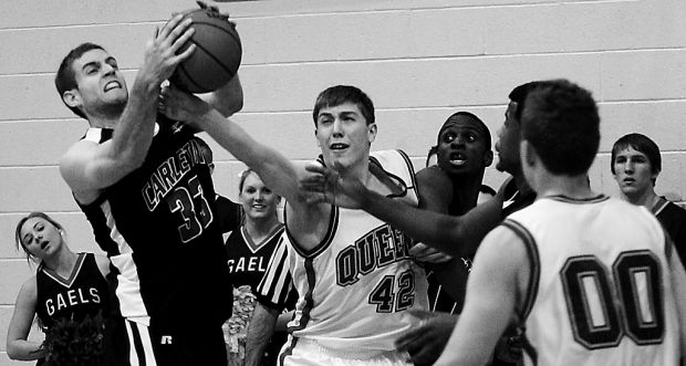 Carleton guard Rob Saunders grabs a rebound over Gael guard Tim Boyle in a Jan. 25 game.