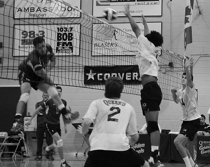 Gaels' middle hitter Michael Amoroso goes up for a block against Ryerson in the OUA semifinals Feb. 16. The Gaels beat the Rams in four sets, but their season ended with two straight losses to the McMaster Marauders in the best-of-three OUA finals.