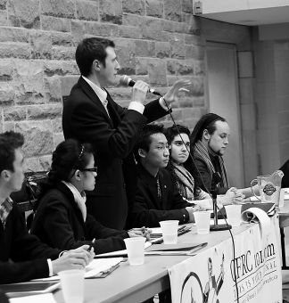 Candidates take questions from students during Wednesday night's rector debate.