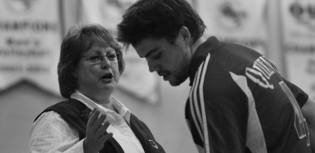 Queen's head coach Brenda Willis talks to setter Devon Miller in a Feb. 9 match against McMaster. Willis says the best Ontario teams should compete against Canada West schools during regular league play to gain experience against tough teams.