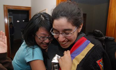 Rector-elect Leora Jackson celebrates her win with friends Wednesday night.