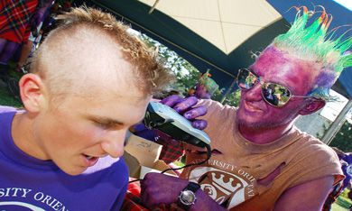 """A FREC gives a Sci '12 frosh a custom cut during the annual """"EngCut Palooza,"""" held at Agnes Benidickson Field Wednesday."""