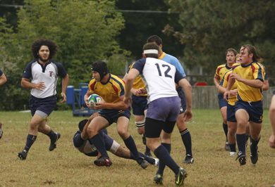 Queen's flanker Alistair Clark breaks a tackle in an August 30 exhibition game against West Point. The men's rugby squad will host the University of Ulster at Coleraine Saturday in an exhibition match at 2:30 p.m. at Kingston Field.