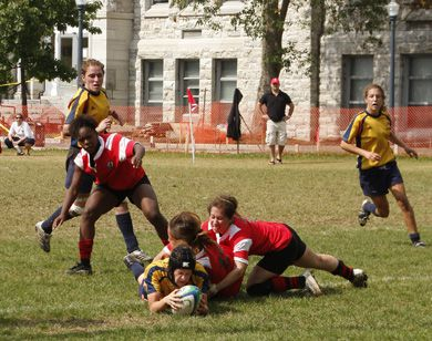 Gaels' flyhalf Emily Stern scores a try Sunday at Kingston field as teammates Shauna Geerts (centre) and Julie Englehardt (right) look on.