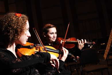 Roslyn Green and Emma Ferner play as part of the Kingston Symphony Orchestra who triumphantly returned to the Grand Theatre on Saturday night.