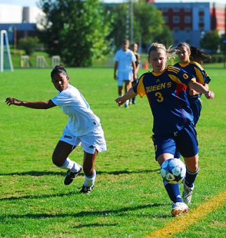 Gaels' striker Kelli Chamberlain tries to keep the ball in play against Laurentian's Krista Pantin in Sunday's game at Richardson Stadium. Queen's lost 1-0, but beat Ottawa 2-0 on Saturday.