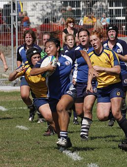 Gaels Jocelyn Poirier (left) and Emily Stern track down Varsity Blues' inside centre Jenny So in Saturday's game. Queen's won 19-12.