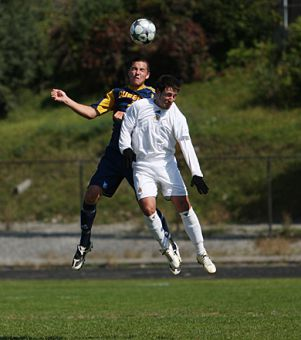 Gaels' defender Andrew Nador (4) goes up for a header against Laurentian's Tony Tagliafiero Sunday.