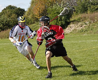 Gaels' defender Strat Allen tries to chase down Carleton's Jesse Ambridge in Sunday's game. Queen's beat the Ravens 13-8.