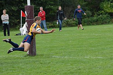 Queen's outside centre Zach Pancer scores a try against McMaster Saturday.