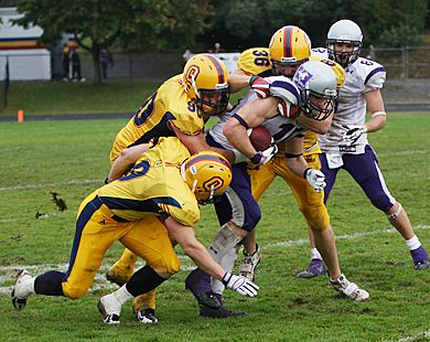 The Gaels' Pat Corbin (90), Tim Poffley (36) and Riley Chisholm (9) bring down Western's Craig Butler in Saturday's game.