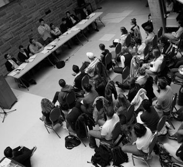 Onlookers watch leaders of the student political clubs debate issues of the upcoming federal election Wednesday night in the Lower Ceilidh of the JDUC.