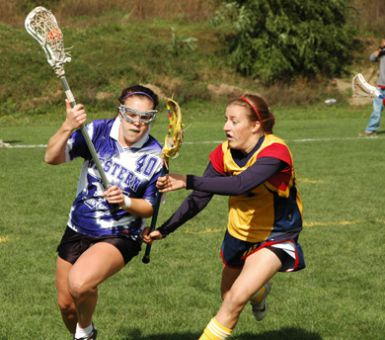 The Gaels' Helen Waters guards the Mustangs' Carrie White at North Field in an 8-7 loss.