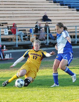Gaels' midfielder Erin Smith slides to clear the ball against Ryerson's Susanne Briggs Saturday.