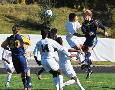 Gaels' defender Michael Zanetti heads the ball against the Blues' Yannis Gianniotis Sunday. Queen's and Toronto tied 1-1.