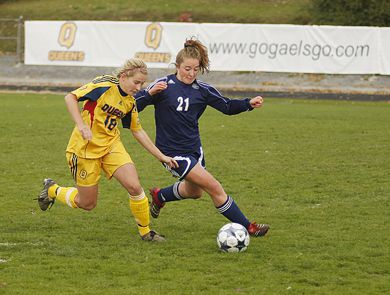 Gaels' striker Jen Hutchinson races Nipissing's Amy Laidlaw for a ball in Wednesday's OUA quarterfinal at Richardson Stadium.