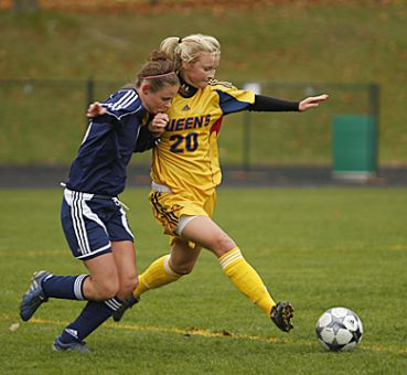 Queen's defender Sara Buckham battles Nipissing's Leesa Church for the ball in Wednesday's game. The Gaels won 2-0.