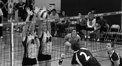 Queen's outside hitter Lorna Button and middle hitter Christiane Taylor go up for a block against Ottawa outside hitter Veronique Yeon Friday in Bartlett Gym.