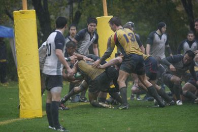 Queen's fly-half Calum Ramsay pushes through to score a try in Saturday's victory.