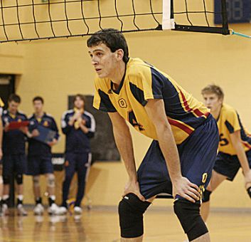 Male athlete of the week Dan Rosenbaum (4) and the Gaels prepare to receive a serve Saturday against the Laurier Golden Hawks.