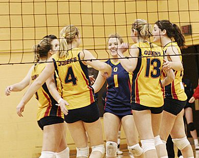 Female athlete of the week Lorna Button (4) celebrates a point with her teammates Saturday at Bartlett Gym.