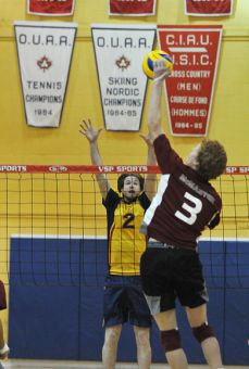 Gaels' outside hitter Jeff DeMeza goes for a block against McMaster Saturday at Bartlett Gym. Queen's won in five sets.