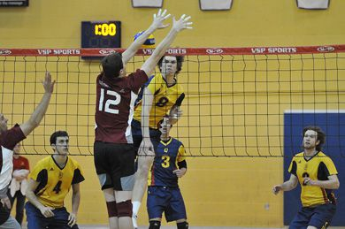 Queen's middle hitter Sam Pedlow gets blocked by McMaster's Tyler Santoni Saturday at Bartlett Gym. McMaster lost for the first time since 2007.