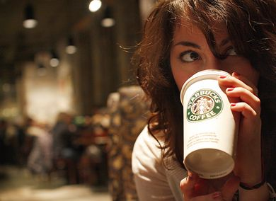 "As consumers world-wide scale back on ""luxury goods,"" how will Starbucks, purveyor of $5 coffees, fare?"