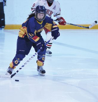 Queen's forward Elizabeth Kench stickhandles with York's Mandy Cole in pursuit Jan. 17. The Gaels face the Guelph Gryphons at 2:30 p.m. Sunday at the Memorial Centre.